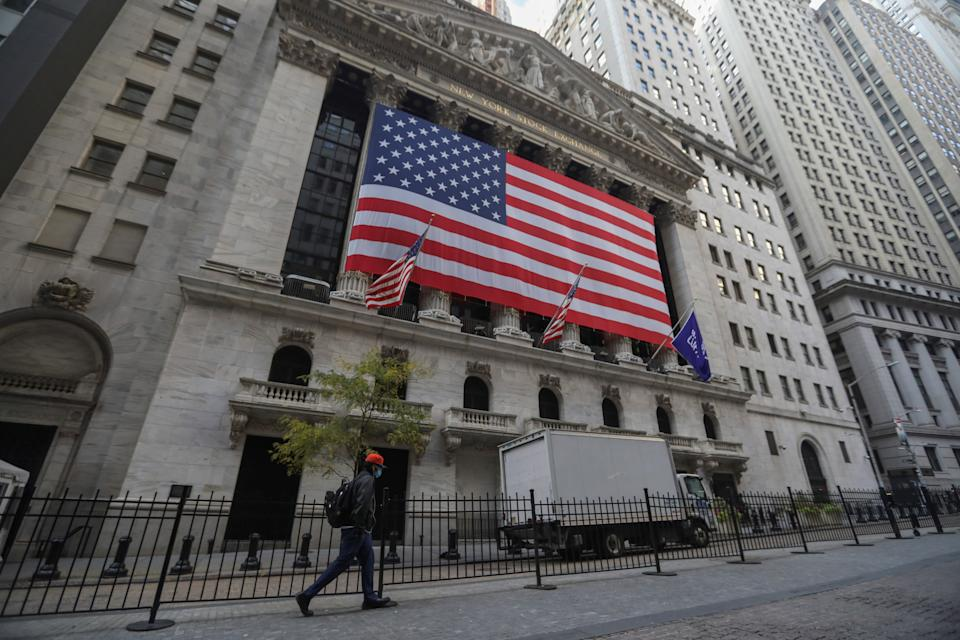 A pedestrian walks past the New York Stock Exchange in New York, the United States, Oct. 30, 2020