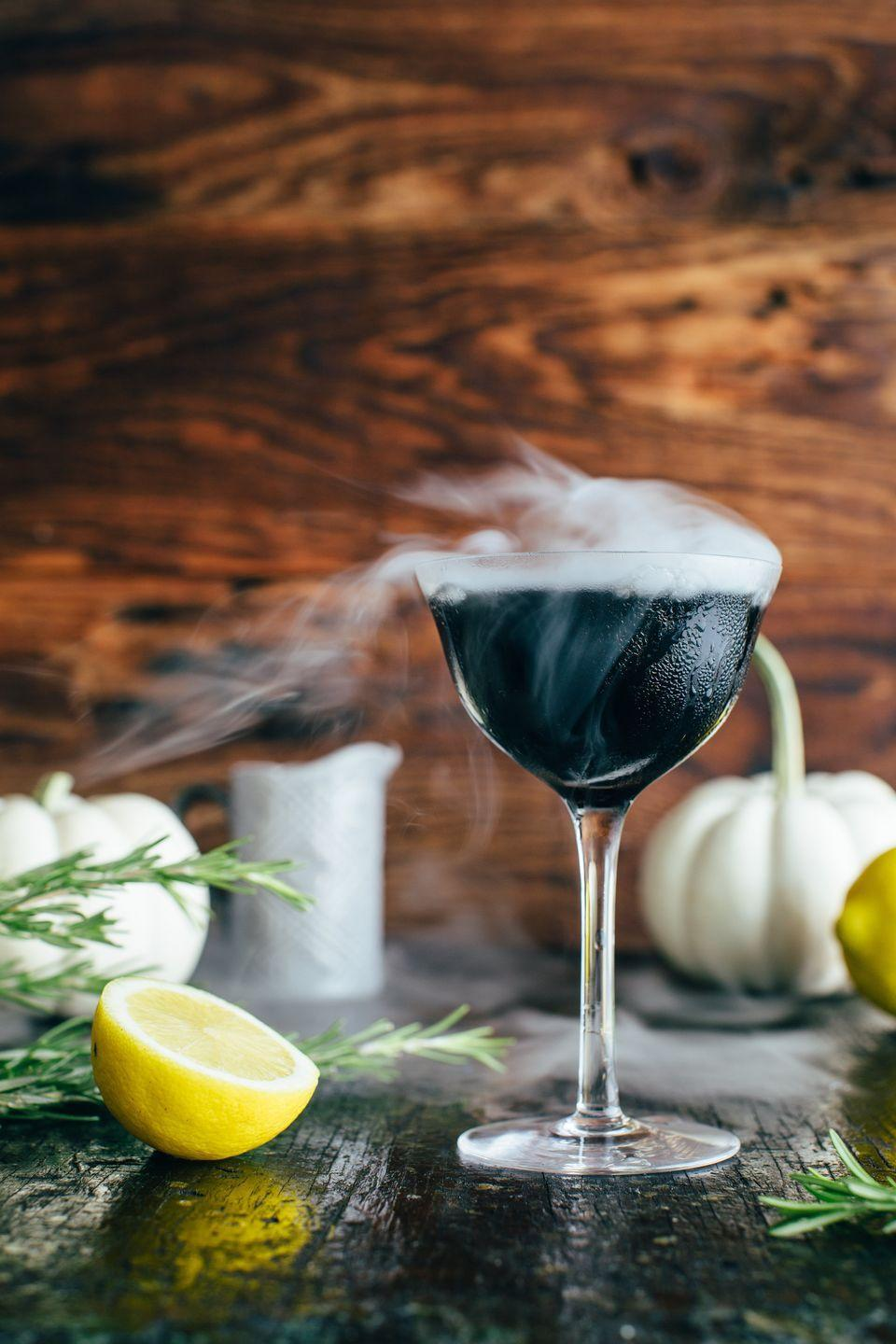 """<p>This jet-black cocktail has a chilling mist that's eery <em>and</em> fun. It's made with bourbon and a homemade rosemary cola syrup that's easy to prep ahead of your Halloween party. </p><p><strong>Get the recipe at <a href=""""https://www.kitchenkonfidence.com/2019/10/midnight-fog-a-halloween-cocktail-recipe"""" rel=""""nofollow noopener"""" target=""""_blank"""" data-ylk=""""slk:Kitchen Konfidence"""" class=""""link rapid-noclick-resp"""">Kitchen Konfidence</a>. </strong></p><p><a class=""""link rapid-noclick-resp"""" href=""""https://go.redirectingat.com?id=74968X1596630&url=https%3A%2F%2Fwww.walmart.com%2Fsearch%2F%3Fquery%3Dglasses&sref=https%3A%2F%2Fwww.thepioneerwoman.com%2Fholidays-celebrations%2Fg36982659%2Fhalloween-drink-recipes%2F"""" rel=""""nofollow noopener"""" target=""""_blank"""" data-ylk=""""slk:SHOP GLASSES"""">SHOP GLASSES</a></p>"""