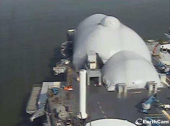 Webcam view of the fully-inflated pavilion covering the space shuttle Enterprise on the flight deck of the Intrepid Sea, Air & Space Museum in New York City, June 21, 2012.