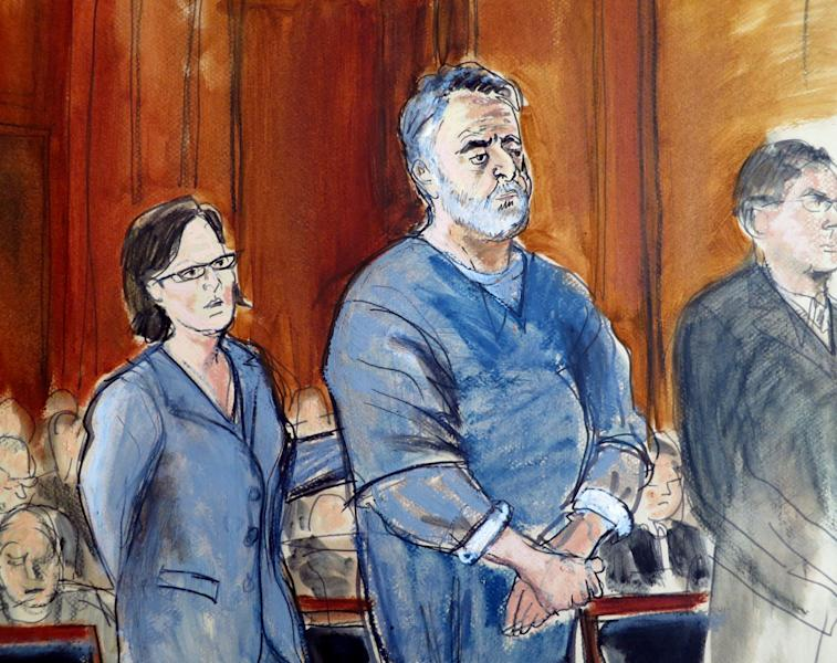 In this courtroom sketch, Manssor Arbabsiar, center, stands with his attorneys Thursday, May 30, 2013, in Manhattan Federal Court, in New York where the judge sentenced the former used car salesman from Corpus Christi, Texas, to 25 years in prison in a failed conspiracy to kill the Saudi Arabian ambassador to the United States by bombing a Washington restaurant. At left, Federal Defender Sabrina Shroff put her hand on Arbabsiar's back as U.S. District Judge John Keenan, not shown, read the sentence. (AP Photo/Elizabeth Williams)