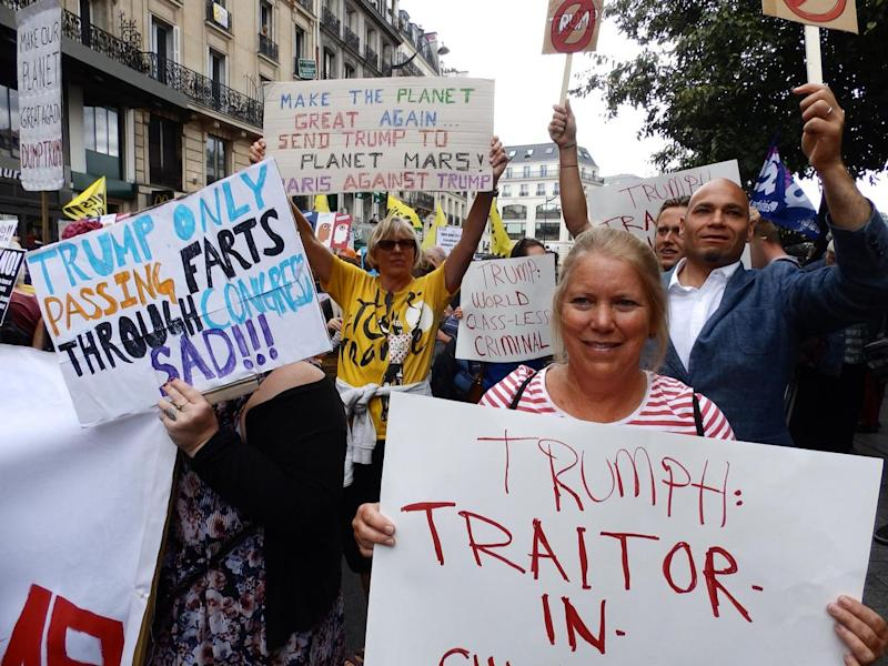 Protesters from the Droits Devant migrants' rights group at a Bastille Day march in Paris on 14 July 2017 (Lizzie Dearden)