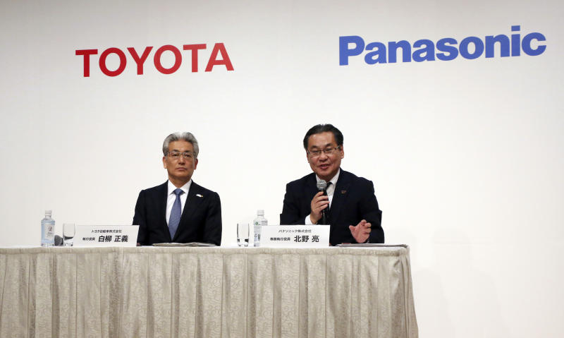 Senior Managing Executive Officer of Panasonic Corporation Makoto Kitano, right, speaks as Operating Officer of Toyota Motor Corporation Masayoshi Shirayanagi listens during a press conference in Tokyo, Thursday, May 9, 2019. Japanese automaker Toyota and electronics maker Panasonic are forming a joint venture combining their housing businesses in Japan. (AP Photo/Koji Sasahara)