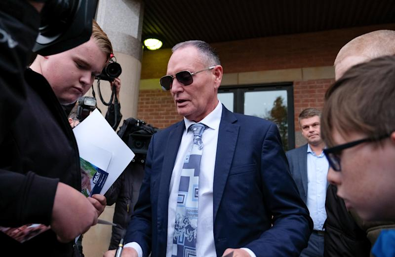 MIDDLESBROUGH, ENGLAND - OCTOBER 14: Former footballer Paul Gascoigne stops to sign autographs as he leaves Teesside Crown Court on October 14, 2019 in Middlesbrough, England. The former player is on trial for sexual assault after he was arrested for kissing a woman in August 2018 while travelling on a train between York and Newcastle. (Photo by Ian Forsyth/Getty Images)