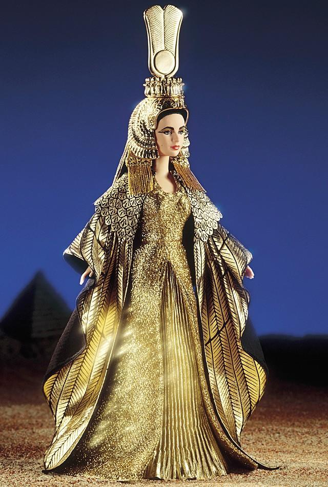 "<div class=""caption-credit""> Photo by: barbiecollector.com</div><b>Elizabeth Taylor in ""Cleopatra,"" released in 2000 for $75</b> <br> This is an older Liz doll. The detailing on this costume is admittedly awesome, and they nailed her dramatic eye makeup."