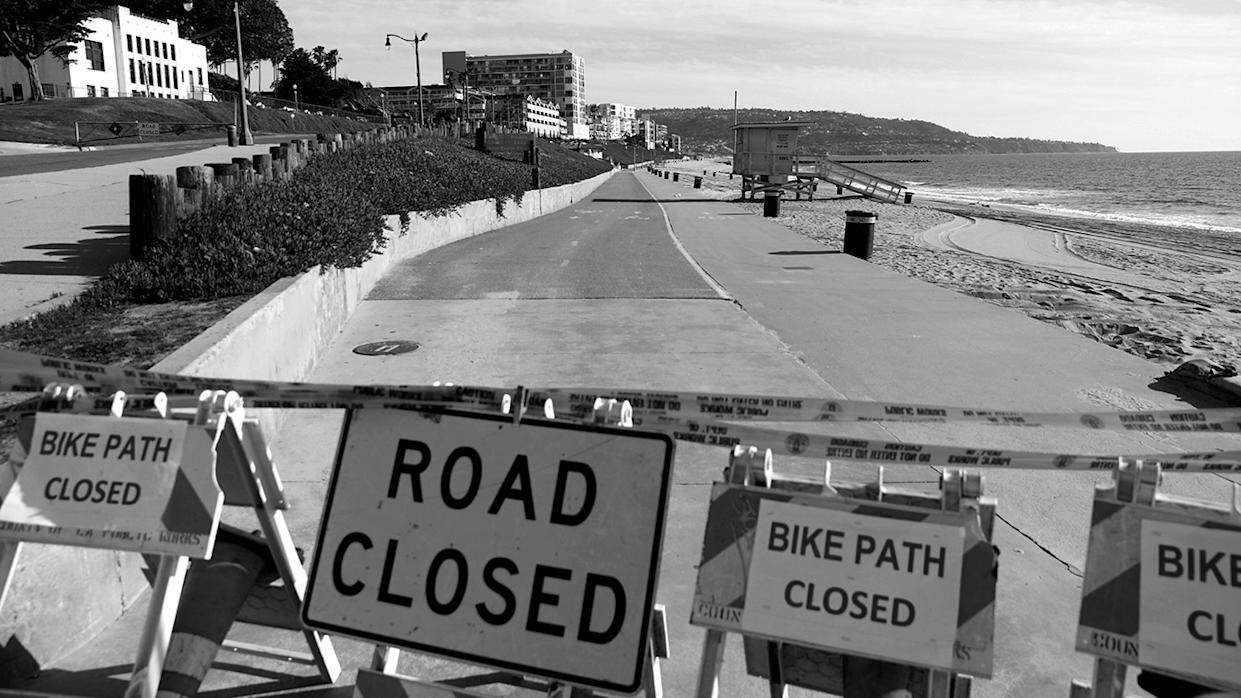 Barriers block the beach after Los Angeles County ordered parks and beaches closed to prevent the spread of coronavirus disease (COVID-19) and encourage social distancing in Redondo Beach, California, U.S., March 28, 2020. REUTERS/Patrick T. Fallon