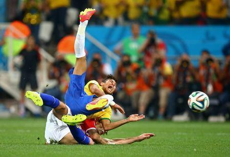 Jun 12, 2014; Sao Paulo, BRAZIL; Brazil forward Neymar (top) is upended by Croatia defender Vedran Corluka during the second half of the opening game of the 2014 World Cup at Arena Corinthians. Brazil defeated Croatia 3-1. Mark J. Rebilas-USA TODAY Sports