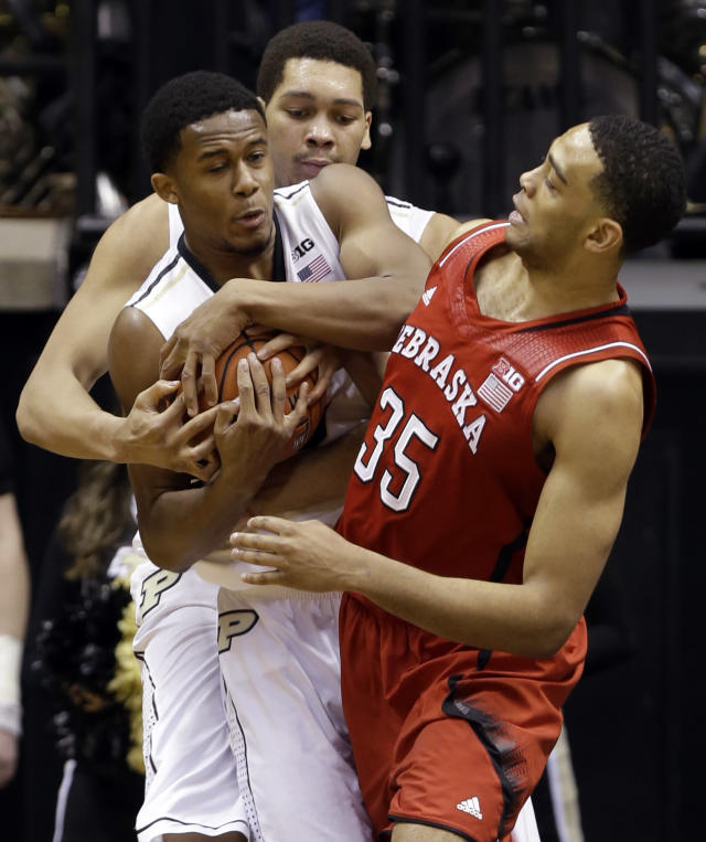 Nebraska forward Walter Pitchford, right, gets tied up with Purdue forward Basil Smotherman, left front, and center A.J. Hammons in the second half of an NCAA college basketball game in West Lafayette, Ind., Sunday, Jan. 12, 2014. Purdue defeated Nebraska 70-64. (AP Photo/Michael Conroy)