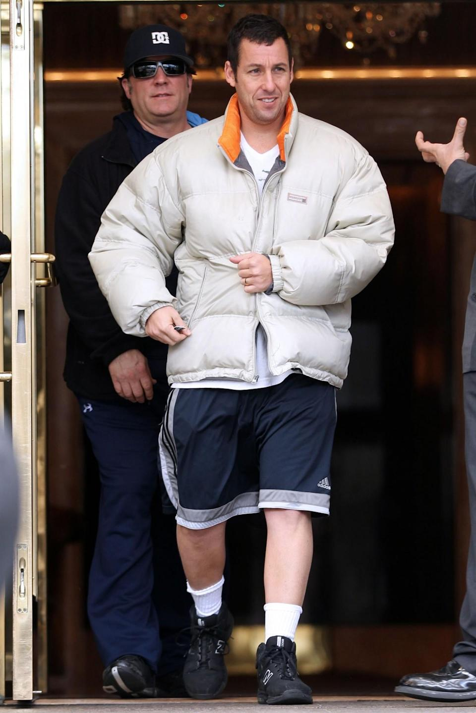 <p>It's never too cold for a pair of Adidas shorts. He paired his gym attire with a puffy coat in 2011. (Photo: Christopher Peterson/BuzzFoto/FilmMagic)</p>
