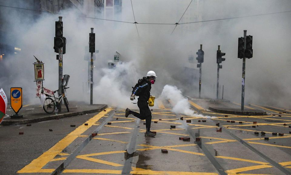 An anti-government protester amid clouds of tear gas in Wan Chai on October 5, 2019. Photo: Sam Tsang