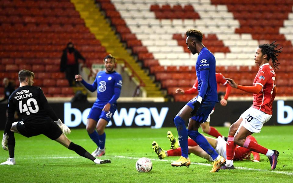 Tammy Abraham of Chelsea scores their sides first goal during The Emirates FA Cup Fifth Round match between Barnsley and Chelsea at Oakwell Stadium on February 11, 2021 in Barnsley, England. - GETTY IMAGES