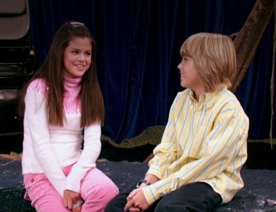 Selena Gomez talks to Cole Sprouse onstage