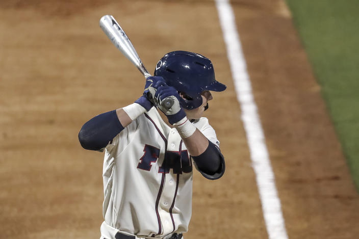 Florida Atlantic freshman catcher Caleb Pendleton bats in the second inning against UCF on Saturday, Feb. 20, 2021, in Boca Raton, Fla. Pendleton became the eighth Division I player to hit two grand slams in one inning and first to do it in the first two plate appearances of his career. (FAU Athletics via AP)