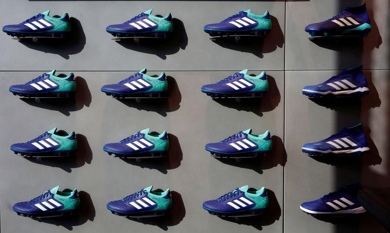 Adidas soccer shoes are displayed at soccer shop KAMO in Tokyo