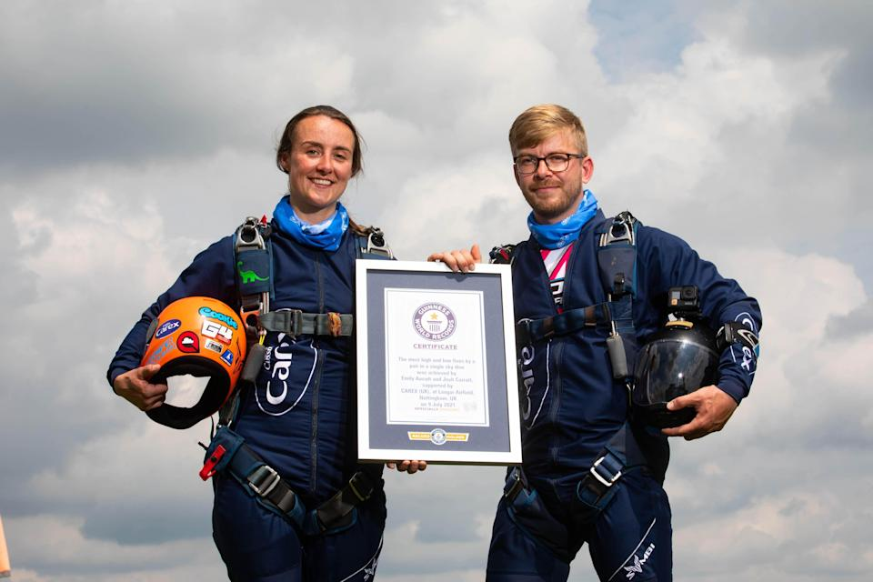 Emily Aucutt and Josh Carratt managed 32 high or low fives during their skydive (David Parry/PA)