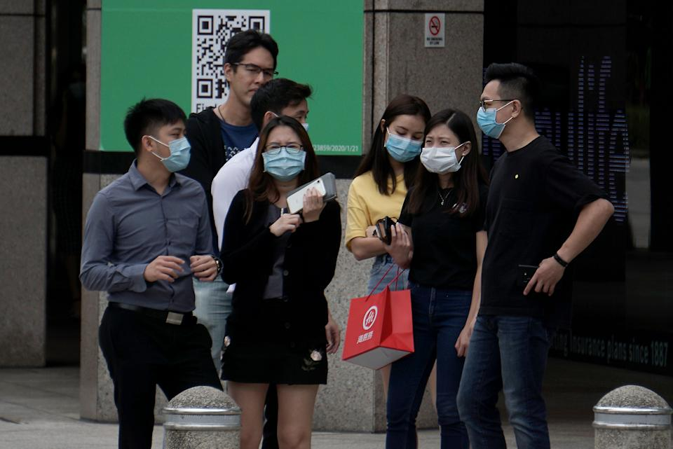 Office workers in face masks seen in the central business district on 7 April 2020, the first day of Singapore's month-long circuit breaker period. (PHOTO: Dhany Osman / Yahoo News Singapore)