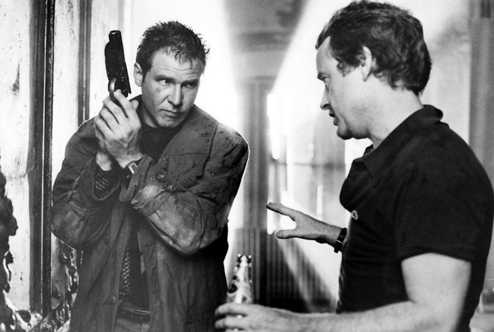 <p>Harrison Ford and director Ridley Scott map out an intense scene in Blade Runner. </p>