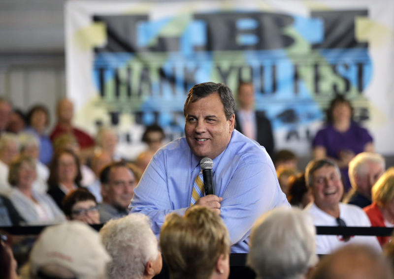 New Jersey Gov. Chris Christie smiles as he listens to a question Tuesday, April 30, 2013, in Long Beach Township, N.J., during a town hall meeting. (AP Photo/Mel Evans)