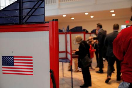 People vote for the mid-term elections, at the Presbyterian Church in Mt. Kisco, New York, U.S., November 6, 2018. REUTERS/Caitlin Ochs