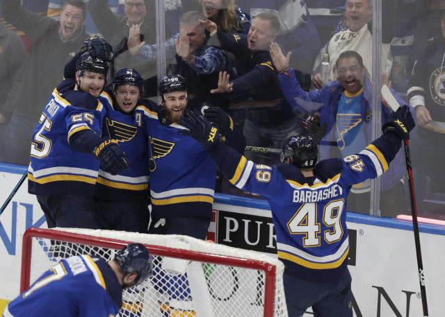 St. Louis Blues' Ryan O'Reilly (90) celebrates with teammates Vladimir Tarasenko (91), Colton Parayko (55) and Ivan Barbashev (49) after scoring in overtime in the team's NHL hockey game against the Toronto Maple Leafs, Tuesday, Feb. 19, 2019, in St. Louis. The Blues won 3-2. (AP Photo/Tom Gannam)