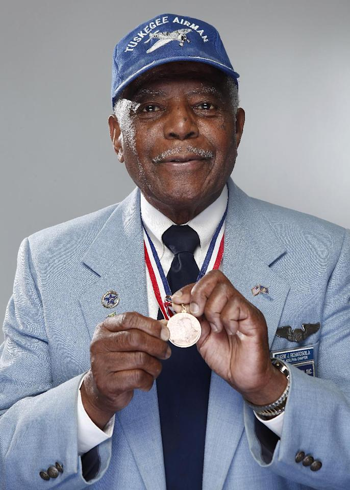 "In this Jan. 10, 2012 photo, Tuskegee airman Eugene J. Richardson, Jr. poses with his medal during the ""Red Tails"" press junket in New York. ""Red Tails,"" a film that chronicles the heroism of the Tuskegee Airmen, opens Friday, Jan. 20. (AP Photo/Carlo Allegri)"