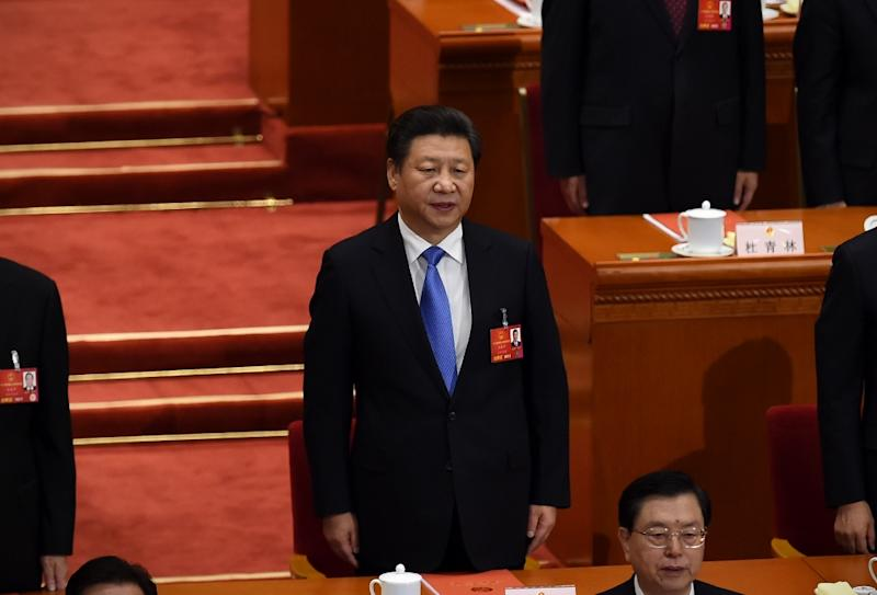 Willy Lam, expert on politics at the Chinese University of Hong Kong, said there was a 60 to 70 percent chance that Xi would refuse to give up the role of party general secretary (AFP Photo/Wang Zhao)