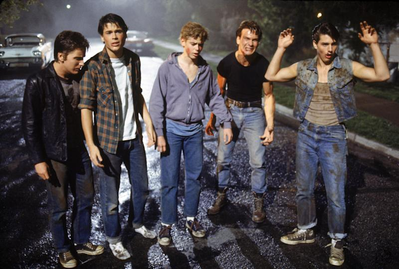 American actors Emilio Estevez, Rob Lowe, Thomas C. Howell, Patrick Swayze, and Tom Cruise on the set of The Outsiders, directed by Francis Ford Coppola. (Photo by Sunset Boulevard/Corbis via Getty Images)
