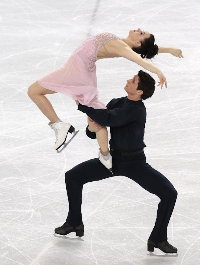 Tessa Virtue and Scott Moir of Canada compete in the ice dance free dance figure skating finals at the Iceberg Skating Palace during the 2014 Winter Olympics, Monday, Feb. 17, 2014, in Sochi, Russia. (AP Photo/Ivan Sekretarev)