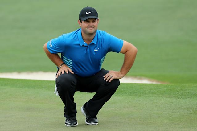 Patrick Reed of the U.S. looks over his putt on the second green during third round play of the 2018 Masters golf tournament at the Augusta National Golf Club in Augusta, Georgia, U.S. April 7, 2018. REUTERS/Lucy Nicholson