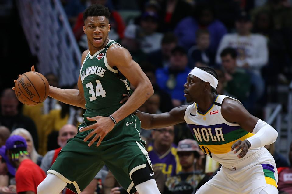 Giannis Antetokounmpo works opposite his new teammate Jrue Holiday. (Jonathan Bachman/Getty Images)