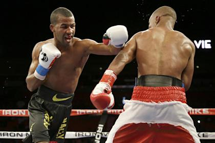 Rances Barthelemy, left, fights Argenis Mendez on Friday, July 11, 2014. (AP)
