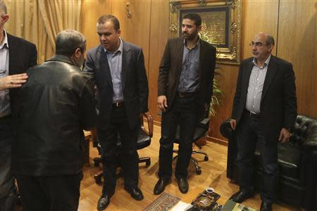 Hezbollah MP Hassan Fadlallah (2nd L) accepts condolences inside Hezbollah al-Manar Television building in Beirut for the death of three Lebanese journalists working for the channel
