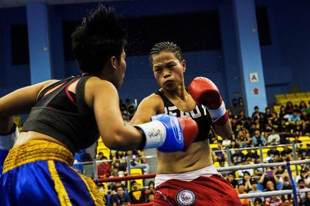 Huang Wensi fights against Thailand's Jarusiri Rongmuang for the Asia Female Continental Super Flyweight Championship gold belt in Taipei, Taiwan, September 26, 2018. REUTERS/Yue Wu