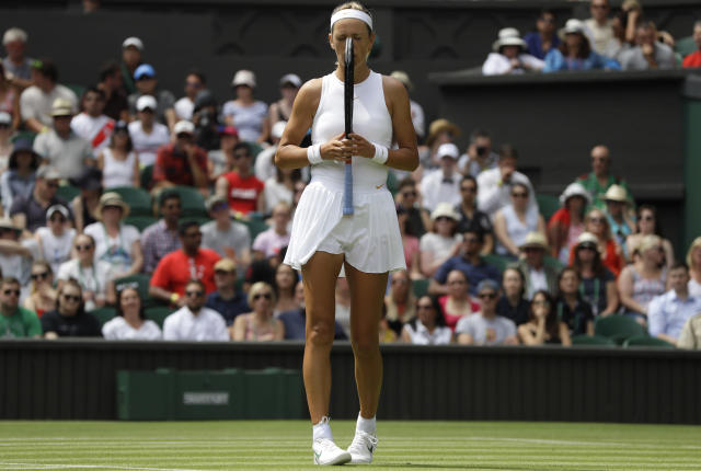 Victoria Azarenka, of Belarus, chews on her racket after loosing a point to Czech Republic's Karolina Pliskova, during their women's singles match, on the third day of the Wimbledon Tennis Championships, in London, Wednesday July 4, 2018. (AP Photo/Kirsty Wigglesworth)