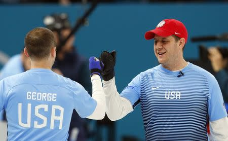 Curling - Pyeongchang 2018 Winter Olympics - Men's Semi-final - Canada v U.S. - Gangneung Curling Center - Gangneung, South Korea - February 22, 2018 - Vice-skip Tyler George and skip John Shuster of the U.S. gesture during the game. REUTERS/Phil Noble