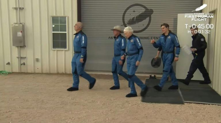 This still image taken from video by Blue Origin shows (L-R) Mark Bezos, Jeff Bezos, Wally Funk and Oliver Daemen as they travel to the launch pad for the Blue Origin flight