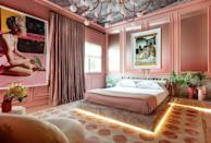 """<p>For this Italian-contessa-meets-Palm-Beach guest suite, <a href=""""https://ninamagon.com/"""" rel=""""nofollow noopener"""" target=""""_blank"""" data-ylk=""""slk:Magon"""" class=""""link rapid-noclick-resp"""">Magon</a> created a custom bed upholstered in velvet by <a href=""""https://fabricut.com/sharris/fabric/1317301/lilith-ombre/rose-quartz"""" rel=""""nofollow noopener"""" target=""""_blank"""" data-ylk=""""slk:Fabricut"""" class=""""link rapid-noclick-resp"""">Fabricut</a> and framed in <a href=""""https://www.cosentino.com/usa/colors/dekton/taga/"""" rel=""""nofollow noopener"""" target=""""_blank"""" data-ylk=""""slk:Taga Dekton"""" class=""""link rapid-noclick-resp"""">Taga Dekton</a> by <a href=""""https://www.cosentino.com/usa/"""" rel=""""nofollow noopener"""" target=""""_blank"""" data-ylk=""""slk:Cosentino"""" class=""""link rapid-noclick-resp"""">Cosentino</a>. The rug is by New Moon, the chandelier is a custom color from <a href=""""https://www.studiomlighting.com/"""" rel=""""nofollow noopener"""" target=""""_blank"""" data-ylk=""""slk:Studio M"""" class=""""link rapid-noclick-resp"""">Studio M</a>, and the art is from <a href=""""https://www.holdenluntz.com/"""" rel=""""nofollow noopener"""" target=""""_blank"""" data-ylk=""""slk:Holden Luntz Gallery"""" class=""""link rapid-noclick-resp"""">Holden Luntz Gallery</a>.</p>"""