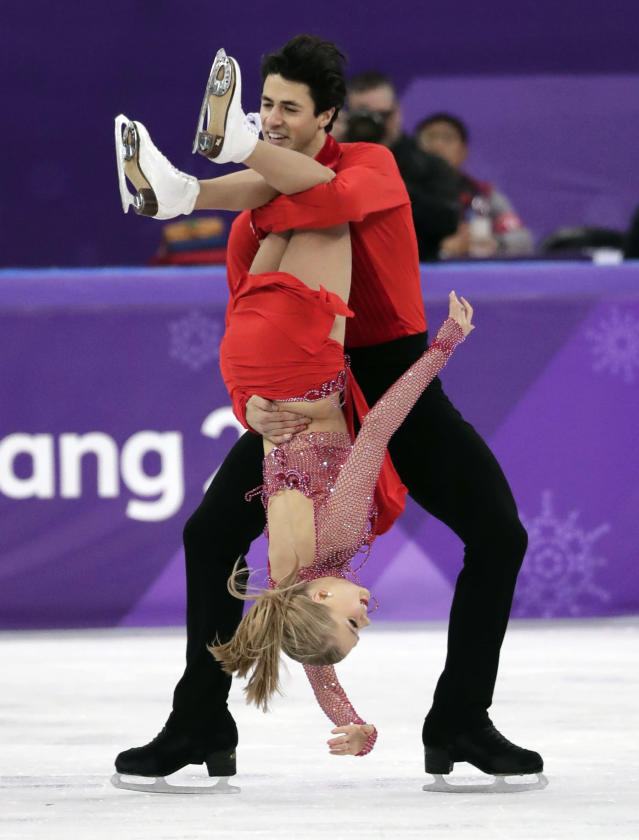<p>Kaitlyn Weaver and Andrew Poje of Canada perform during the ice dance, short dance figure skating in the Gangneung Ice Arena at the 2018 Winter Olympics in Gangneung, South Korea, Monday, Feb. 19, 2018. (AP Photo/Julie Jacobson) </p>