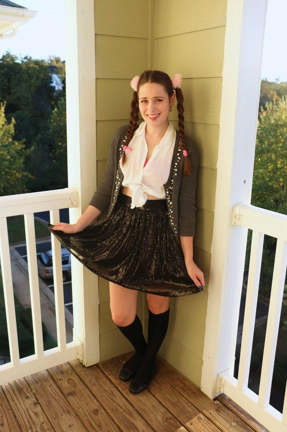 """<p>Take note from the princess of pop with this iconic outfit.</p><p><strong>Get the tutorial at <a href=""""http://www.southernbelleintraining.com/2018/10/easy-diy-halloween-costume-britney.html"""" rel=""""nofollow noopener"""" target=""""_blank"""" data-ylk=""""slk:Southern Belle in Training"""" class=""""link rapid-noclick-resp"""">Southern Belle in Training</a>.</strong></p><p><strong><a class=""""link rapid-noclick-resp"""" href=""""https://www.amazon.com/FLORIA-Classic-Cropped-Cardigan-HEATHERGREY2/dp/B073ZNVS1M?tag=syn-yahoo-20&ascsubtag=%5Bartid%7C10050.g.22118522%5Bsrc%7Cyahoo-us"""" rel=""""nofollow noopener"""" target=""""_blank"""" data-ylk=""""slk:SHOP CARDIGANS"""">SHOP CARDIGANS</a><br></strong></p>"""