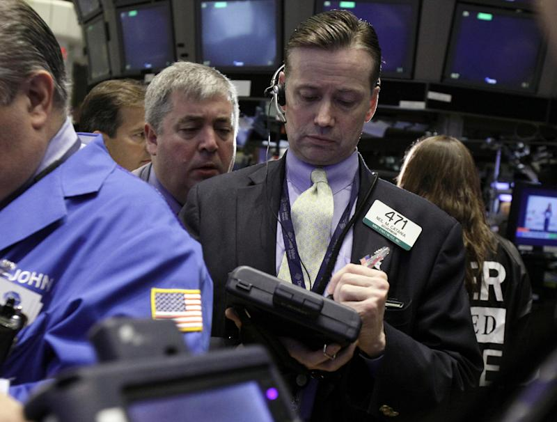 Neil Catana, right, works with fellow traders on the floor of the New York Stock Exchange Thursday, May 3, 2012. Markets were on edge Friday ahead of crucial U.S. jobs figures and weekend elections in France and Greece that could have a big bearing on how Europe's debt crisis plays out over the coming months.  (AP Photo/Richard Drew)
