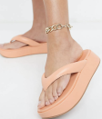 """A classic shape, updated with a pretty pastel peach. The <em>Clueless</em> TV-spinoff vibes are strong with this one. $26, ASOS. <a href=""""https://www.asos.com/us/asos-design/asos-design-wide-fit-ferris-chunky-flip-flop-sandals-in-peach/prd/21821521"""" rel=""""nofollow noopener"""" target=""""_blank"""" data-ylk=""""slk:Get it now!"""" class=""""link rapid-noclick-resp"""">Get it now!</a>"""
