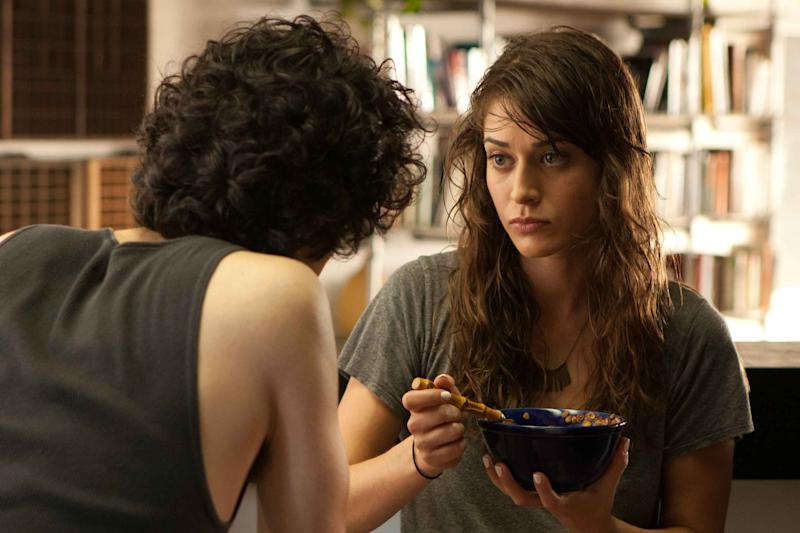 """This film image released by IFC Films shows Lizzy Caplan, right, and Geoffrey Arend in a scene from """"Save the Date."""" (AP Photo/IFC Films)"""