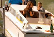 <p>Clooney and Catherine Zeta-Jones leave by water taxi after a press conference at the 60th Venice Film Festival on September 3, 2003 in Venice, Italy.</p>