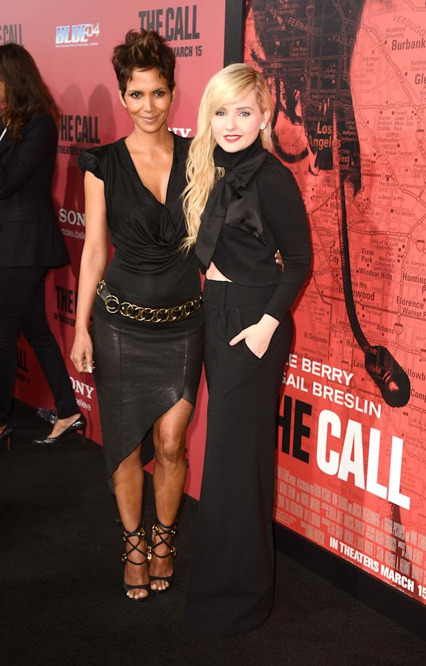 """HOLLYWOOD, CA - MARCH 05:  Actress Halle Berry and actress Abigail Breslin arrive at the premiere Of Tri Star Pictures' """"The Call"""" at ArcLight Cinemas on March 5, 2013 in Hollywood, California.  (Photo by Frazer Harrison/Getty Images)"""