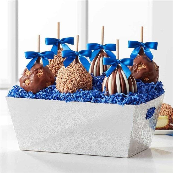 "Hanukkah gelt (a.k.a. chocolate coins) is cute and all, but have you seen Mrs Prindables Gourmet Caramel Apples and Confections gift trays? They are the creme de la creme of <a href=""https://www.glamour.com/story/caramel-candy-apples-kit-recipes?mbid=synd_yahoo_rss"" rel=""nofollow noopener"" target=""_blank"" data-ylk=""slk:candy apples"" class=""link rapid-noclick-resp"">candy apples</a>, and perfect for <a href=""https://www.glamour.com/about/chocolate?mbid=synd_yahoo_rss"" rel=""nofollow noopener"" target=""_blank"" data-ylk=""slk:anyone that loves chocolate"" class=""link rapid-noclick-resp"">anyone that loves chocolate</a>. But good luck picking a favorite among your choice of triple chocolate, milk chocolate walnut, and milk chocolate toffee walnut. $57, Mrs Prindables. <a href=""https://www.mrsprindables.com/festival-of-lights-caramel-apple-gift-tray/"" rel=""nofollow noopener"" target=""_blank"" data-ylk=""slk:Get it now!"" class=""link rapid-noclick-resp"">Get it now!</a>"