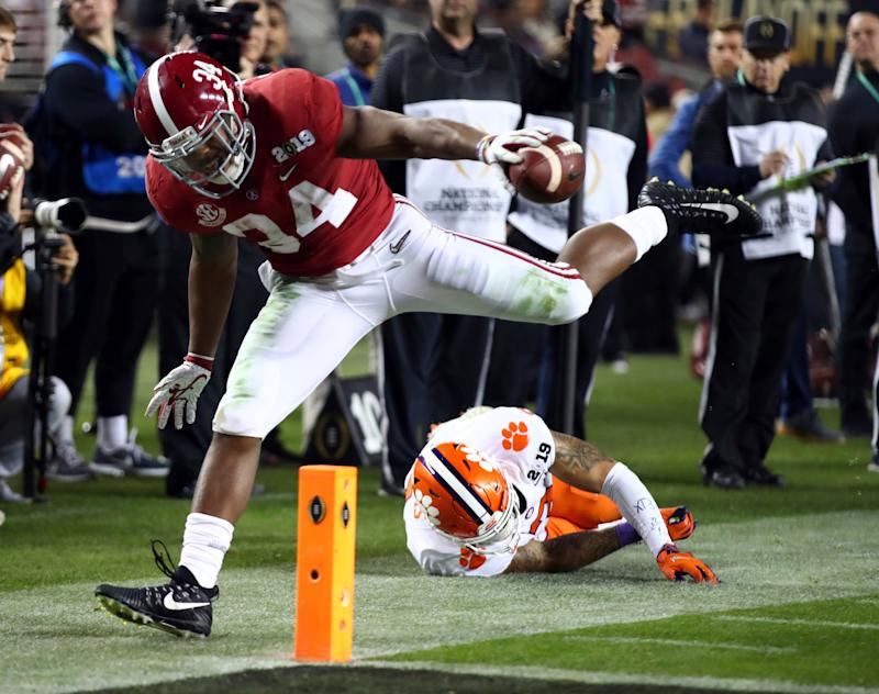 Alabama's Damien Harris is stopped short of the goal line in the college football playoff championship game against Clemson (AP Photo)