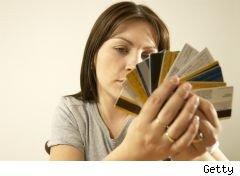 woman looking worried with handful of credit cards