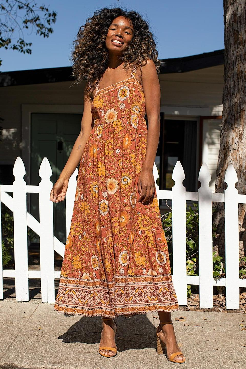 """<br><br><strong>Lulus</strong> In a Groove Rust Brown Floral Print Tie-Strap Maxi Dress, $, available at <a href=""""https://go.skimresources.com/?id=30283X879131&url=https%3A%2F%2Fwww.lulus.com%2Fproducts%2Fin-a-groove-rust-brown-floral-print-tie-strap-maxi-dress%2F1420076.html"""" rel=""""nofollow noopener"""" target=""""_blank"""" data-ylk=""""slk:Lulus"""" class=""""link rapid-noclick-resp"""">Lulus</a>"""