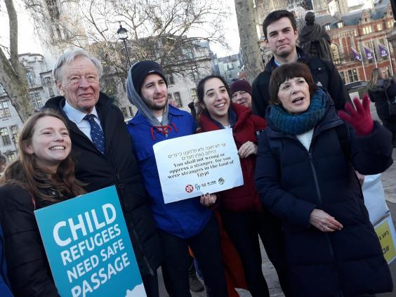 Lord Dubs (second from left) joins campaigners supporting his amendment in Parliament Square