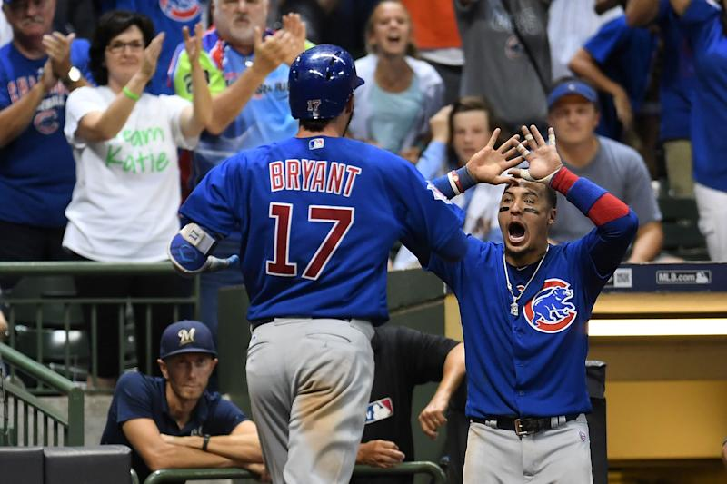 MILWAUKEE, WI - SEPTEMBER 21: Kris Bryant #17 of the Chicago Cubs is congratulated by Javier Baez #9 following a two run home run against the Milwaukee Brewers during the tenth inning of a game at Miller Park on September 21, 2017 in Milwaukee, Wisconsin. (Photo by Stacy Revere/Getty Images)