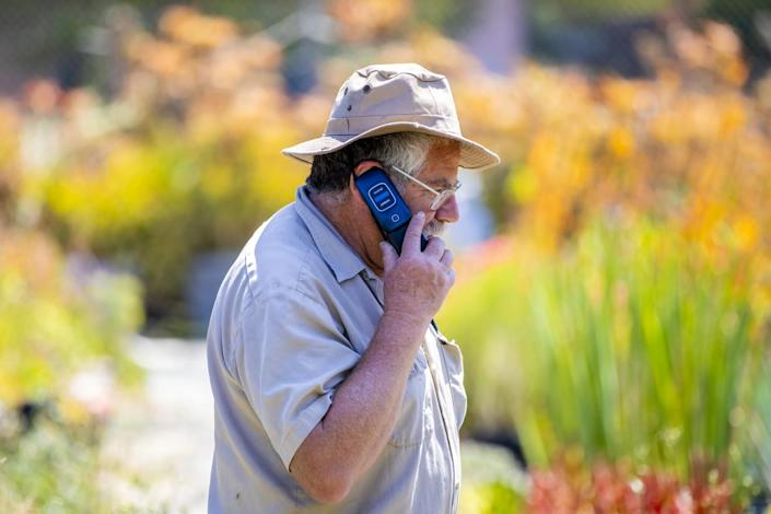 David Bernstein, owner of the Cactus Ranch, takes a call on a flip phone.